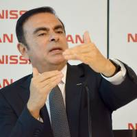 Nissan Motor Co. Chief Executive Officer Carlos Ghosn gestures during a news conference in Rio de Janeiro on Tuesday. | KYODO