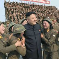 North Korean leader Kim Jong Un is mobbed during a tour of a women's subunit of the Korean People's Army in this shot issued by the Korean Central News Agency on Thursday.   REUTERS