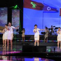 The Moranbong Band, North Korean leader Kim Jong Un's favorite guitar-slinging, miniskirt-sporting girl group, performs in Pyongyang on March 28. | AP