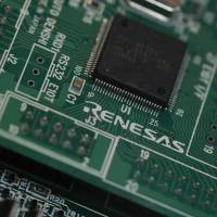 A photo from March 2013 shows a chip made by Renesas Electronics Corp. at the company's office in Tokyo. | REUTERS