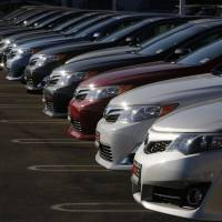 Toyota Camrys and Avalons fill the lot at the DCH Auto Group Dealership in Torrance, California, last July. | BLOOMBERG