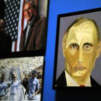 "A portrait of Russian President Vladimir Putin — part of the exhibit ""The Art of Leadership: A President's  Diplomacy"" — are displayed at the George W. Bush Presidential Library and Museum in Dallas on Friday. The exhibit of portraits of world leaders painted by former President George W. Bush was to open Saturday and run through June 3. 