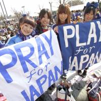 Go team: Female Japanese soccer fans at a charity match in March 2011. | REUTERS