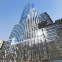 Wealthy Chinese are pouring money into luxury apartment buildings such as One57 in Manhattan, New York. Buyers are using such properties to establish a base for their children to get a Western education. | REUTERS