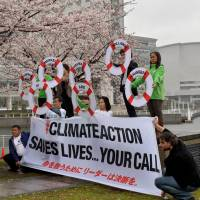 Environmental activists protest against global warming in Yokohama on March 30. | AFP-JIJI