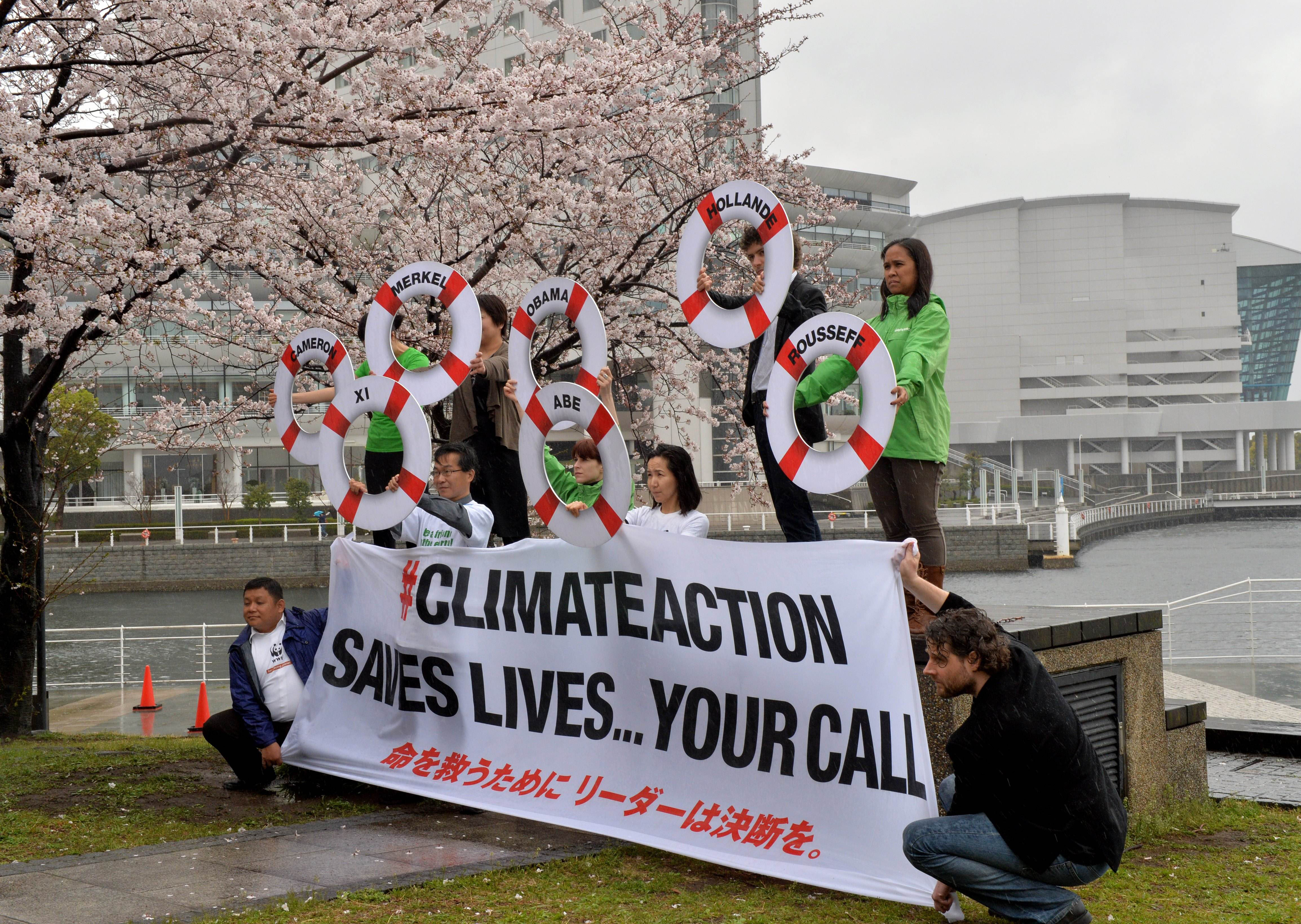 Environmental activists protest against global warming in Yokohama on March 30.   AFP-JIJI