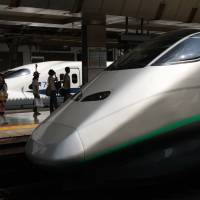 Bullet trains wait at platforms at Tokyo Station. The Fair Trade Commission has ordered a retailing unit of East Japan Railway Co. to stop blocking Ecute tenants from passing the cost of the April 1 sales tax hike onto consumers in the form of higher prices. | BLOOMBERG