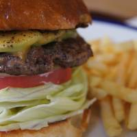 Authentic eats: The avocado cheeseburger at The Corner. | ADAM MILLER