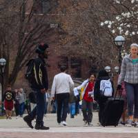 Students walk through the Ann Arbor campus of the University of Michigan on Tuesday. The same day, the U.S. Supreme Court upheld Michigan's ban on affirmative action, which was enacted by voters in 2006. | AP