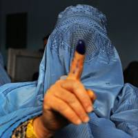 Millions in Afghanistan defy Taliban threat to cast votes in election