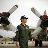 Japan's Maritime Self-Defense Force Cmdr. Hidetsugu Iwamasa is pictured in front of one of the force's P-3C Orion aircraft currently at RAAF Base Pearce near Perth, Australia, on Friday.   REUTERS