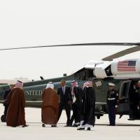 U.S. President Barack Obama (center) bids farewell to Saudi officials before flying back to Washington on Saturday following a visit to Saudi Arabia. Obama sought to reassure Saudi King Abdullah on Friday that he would reject an unfavorable nuclear deal with Iran, during a visit designed to allay the kingdom's concerns that its decades-old alliance with the United States had frayed. | REUTERS