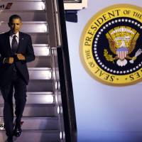 U.S. President Barack Obama arrives at Brussels Airport on March 25 for an EU summit in the Belgian capital. Obama is scheduled to arrive in Tokyo on Wednesday evening, White House officials said ahead of the leader's four-nation tour of Asia. | REUTERS