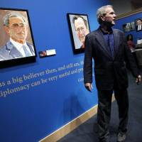 Former President George W. Bush tours his new exhibit, 'The Art of Leadership: A President's Personal Diplomacy' at the George W. Bush Presidential Library in Dallas on Tuesday. | AP