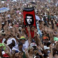A crowd of cheering fans attend the Peace Without Borders concert in Revolution Square, Havana, in September 2009. According to a report Thursday, the U.S. government secretly masterminded the creation of a 'Cuban Twitter' to undermine the communist government in Havana. The peace concert was a perfect opportunity for the U.S. to test out the budding social network dubbed 'ZunZuneo,' Cuban slang for a hummingbird's tweet.   AP