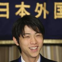 Sochi Winter Olympics men's figure skating gold medalist Yuzuru Hanyu smiles during a press conference at the Foreign Correspondents' Club of Japan in Tokyo on Thursday. The 19-year-old athlete is among the 684 people and 23 groups receiving spring decorations from the government. | AP