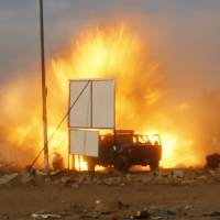 An explosion is seen during a car bomb attack at a Shiite political organization's rally in Baghdad on Friday. | REUTERS