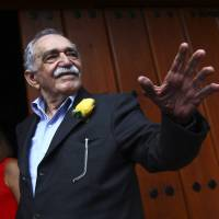 Colombian Nobel Prize laureate Gabriel Garcia Marquez greets journalists on his birthday outside his home in Mexico City on March 6. Garcia Marquez, whose beguiling stories of love and longing brought Latin America to life for millions of readers and put magical realism on the literary map, died Thursday. He was 87. | REUTERS