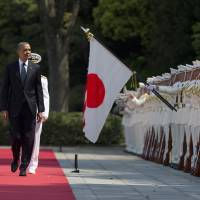 U.S. President Barack Obama reviews an honor guard during a welcome ceremony at the Imperial Palace in Tokyo on Thursday. | REUTERS