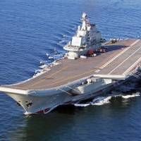 In first, U.S. defense chief visits sole Chinese carrier