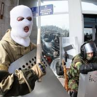 Pro-Russian activists guard the main government administration building in the eastern Ukrainian city of Donetsk on Monday. | AFP-JIJI