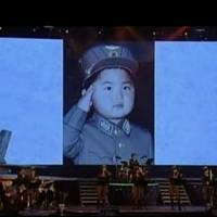An image from video broadcast by North Korean state-run television Monday shows still photos from the childhood of the country's leader, Kim Jong Un, after a concert in Pyongyang. | REUTERS