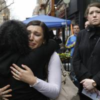 Boston bombing marked with defiant memorial