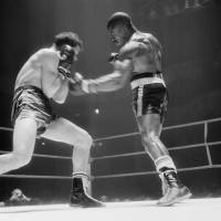 Rubin 'Hurricane' Carter (right) lands a punch on Fabio Bettini of Italy during their international middleweight match in Paris on Feb. 22, 1965. Carter beat Bettini by knockout in the 10th round. | AFP-JIJI