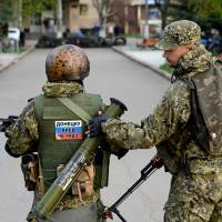 Washington raises pressure on Moscow over Ukraine; pro-Russia separatists vow not to end occupation