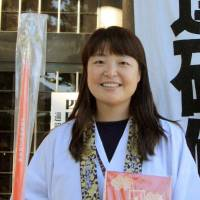 Choi Sang-hee, a South Korean and the first non-Japanese female guide of the 88-temple pilgrimage on Shikoku, poses for a photo in December. | KYODO