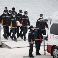 S. Korean ferry sinking death toll tops 100 as criticism of crew mounts