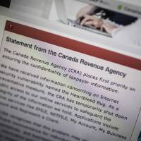 The Canada Revenue Agency website displays information about an Internet security vulnerability called the 'Heartbleed' bug in Toronto on Wednesday. | REUTERS