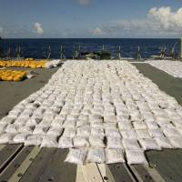 More than 1,000 tons of seized heroin is laid out on HMAS Darwin's flight deck. The seizure was the largest ever at sea. | AFP-JIJI