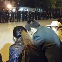 Family members of passengers aboard missing Malaysia Airlines Flight MH370 protest outside the Malaysian Embassy in Beijing early Friday. This photo was provided by family members. | REUTERS