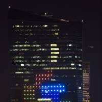 The classic video game Tetris is played on the 29-story Cira Centre in Philadelphia on Saturday using hundreds of LED lights embedded in its glass facade. The spectacle kicked off a citywide series of events called Philly Tech Week and also celebrates the upcoming 30th anniversary of Tetris. | AP