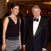 Former New South Wales state Premier Neville Wran arrives with Princess Mary of Denmark at the Victor Chang Royal Ball in Sydney on March 4, 2005. | AFP-JIJI