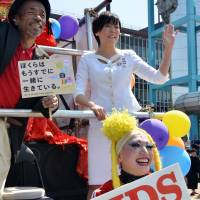 Akie Abe, wife of Prime Minister Shinzo Abe, waves to the crowd during the Tokyo Rainbow Pride parade against AIDS in Tokyo on Sunday. Some 3,000 supporters of the lesbian, gay, bisexual and transgender (LGBT) community came out in costume to march through the Shibuya and Harajuku shopping districts. | AFP-JIJI