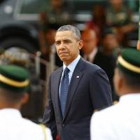 U.S. President Barack Obama inspects a guard of honor during a state welcoming ceremony outside the parliament house in Kuala Lumpur on Saturday. | REUTERS