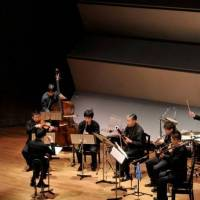 Telling a tale: Conducted by Shoichi Kubota, seven Japanese musicians and actor Jun Kunimura perform Igor Stravinky's 'The Soldier's Tale' at Tokyo Bunka Kaikan Recital Hall on March 16. | SATOSHI AOYAGI