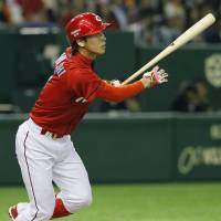 Added bonus: Carp pinch hitter Shota Dobayashi hits a two-run home run in the ninth inning of Tuesday's game at Tokyo Dome. | KYODO