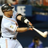 Right on the money: The Giants' Jose Lopez smacks the game-winning home run, a solo shot, in the 10th inning against the BayStars on Tuesday at Yokohama Stadium. Yomiuri beat Yokohama 2-1. | KYODO