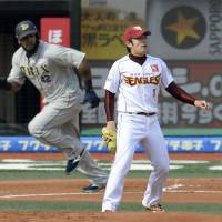 Rude awakening: Rookie Tohoku Rakuten pitcher Yuki Matsui watches Orix slugger Willy Mo Pena's first-inning RBI single during the Golden Eagles' 7-1 loss to the Buffaloes on Wednesday. | KYODO