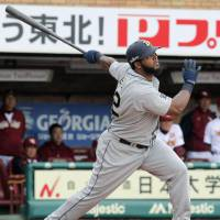 And away it goes: Buffaloes slugger Wily Mo Pena hits a second-inning solo home run against the Eagles on Thursday in Sendai. Orix defeated Tohoku Rakuten 3-1. | KYODO