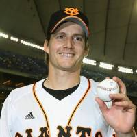 Having a ball: Giants pitcher Chris Seddon poses for photos after winning his first start in Japan on Wednesday night at Tokyo Dome. | KYODO