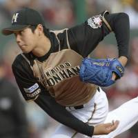 Fighting talk: Hokkaido Nippon Ham's Shohei Otani delivers a pitch during the Fighters' 4-2 win over the Golden Eagles on Sunday. | KYODO