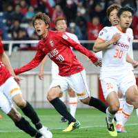 Red tide: Urawa's Tadanari Lee (center) wheels away in celebration after scoring the opening goal in Reds' 2-1 Nabisco Cup win over Omiya Ardija on Wednesday. | KYODO