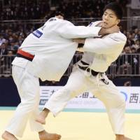 Poised and focused: Judoka Shohei Ono (right) takes Riki Nakaya in the men's 73-kg final on Sunday in Fukuoka at National Invitational Weight Class Championships. | KYODO