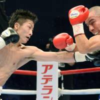 On target: Naoya Inoue lands a punch to Mexican light flyweight Adrian Hernandez's chest during their WBC title fight on Sunday at Ota City General Gymnasium. Inoue claimed the title with a sixth-round TKO. | KYODO