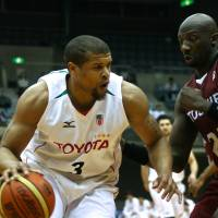 Too close for comfort: Toyota's Jeff Gibbs looks to score against Toshiba's Mamadou Diouf during Friday's game at Todoroki Arena. | KAZ NAGATSUKA