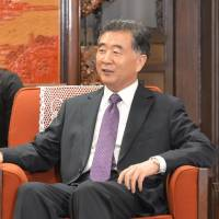 Former Foreign Minister Yohei Kono (left) meets with Chinese Vice Premier Wang Yang in Beijing on Tuesday. | KYODO